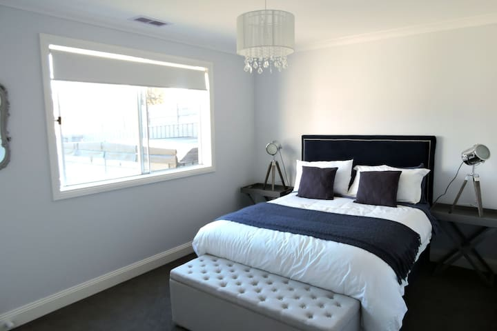 Luxury double room features brand new euro pillow-top bed and velvet headboard,  luxury linen. Ample storage with built in robes and drawers.   Overlooks the peaceful backyard on the ground floor.