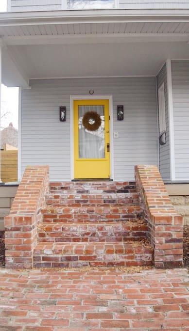 Yellow Front Door & Edison Bulb Sconces