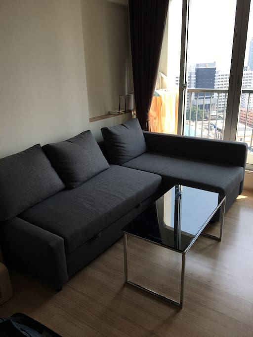 New comfortable sofa in living room which can be converted to bed for 2 people