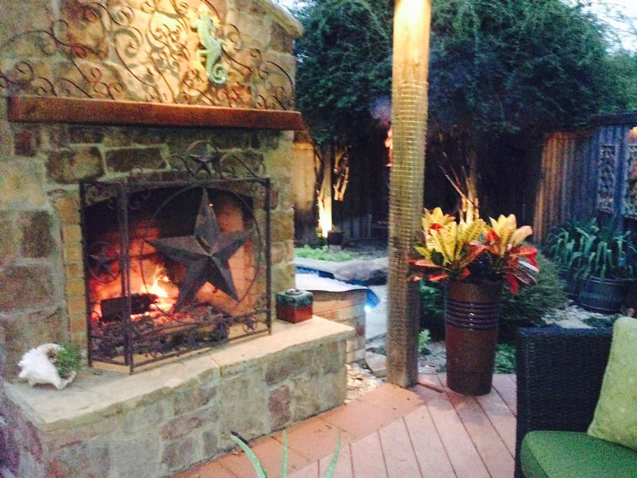 Wood burning exterior fireplace for chilly nights and mornings