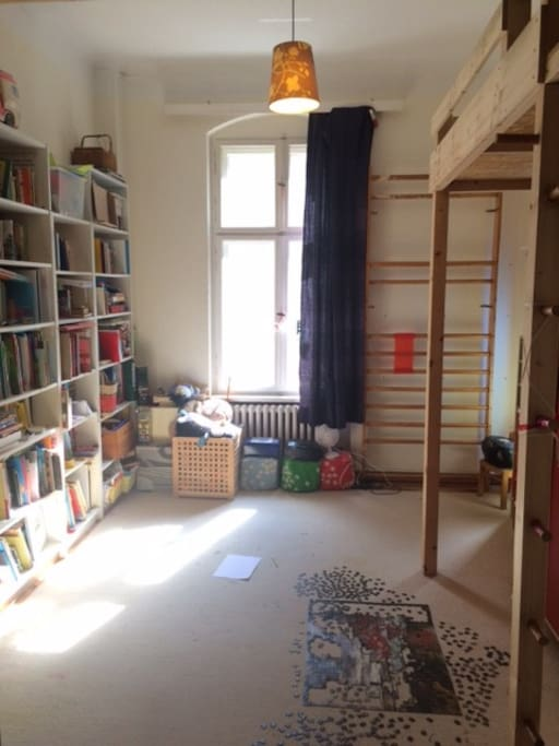 This is the kids' room. There are 2 loft beds (to the right, one above me). Loads of English and German books and games for all ages.