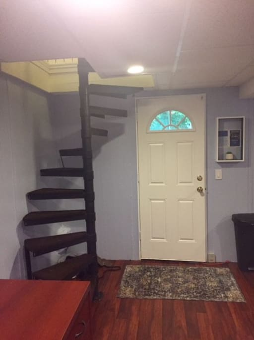 Lower-level deck entrance. Spiral staircase leads to the upstairs kitchen.