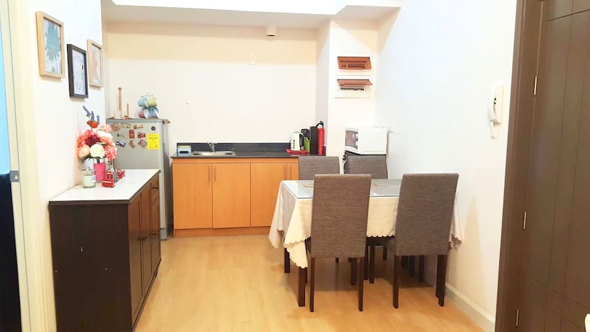 Dining and kitchen area equipped with microwave, fridge, perculator and breadtoaster