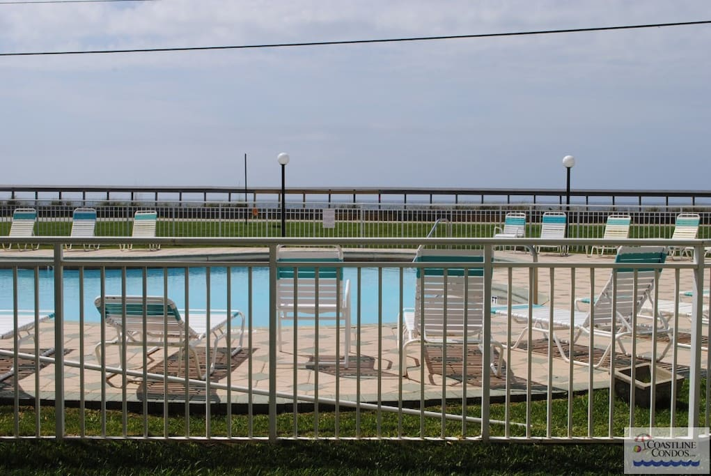 Enjoy the View of the Pool and the Gulf from your Ground Floor Patio