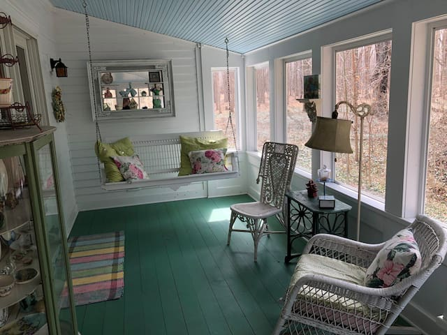 Wrap-around porch with swing
