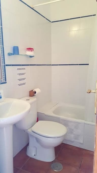 Shower room with a half bath.