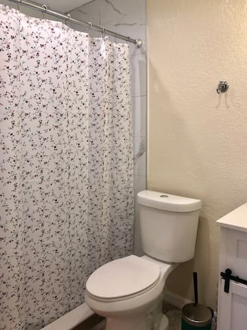 Bathroom is always kept clean. Included a trashcan, toilet bowl brush, and plenty of toilet paper