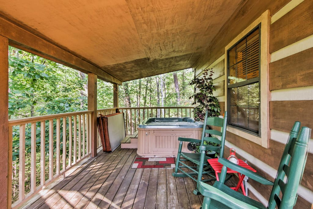 Sip your morning coffee while rocking in the chairs or soak in the private hot tub on the deck.