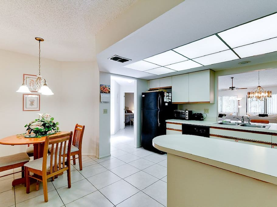 Full, bright kitchen with serving window.