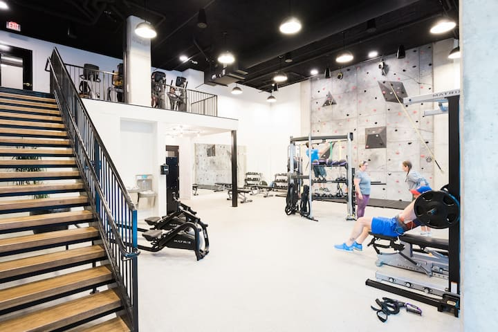 The building also has a full gym equipped with everything you need and there's even a rock climbing wall. It's located on the 1st floor.