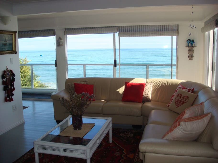 Lounge area on the middle floor leading onto balcony overlooking the ocean