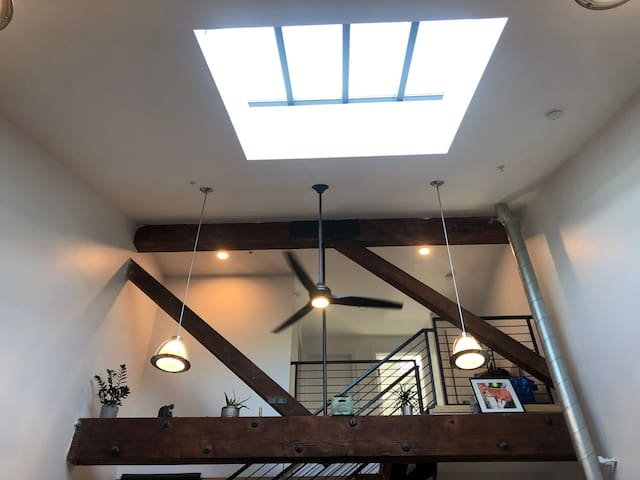 Second level and living room skylight view-