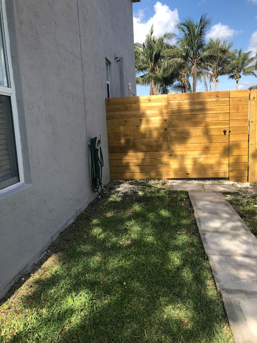 Guest suite entrance accessed from the left side of the home (on the right side of the home if your are facing it from guest parking spot on the grass in front of the mailbox/home.