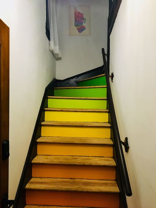 Welcome to your vacation home. The entry stairs. Color is life!