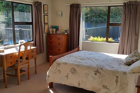 Sunny  spacious room with outside entrance to Pool - Hastings