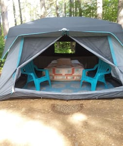 Plush Queen Bed In Spacious Glam Camp Tent