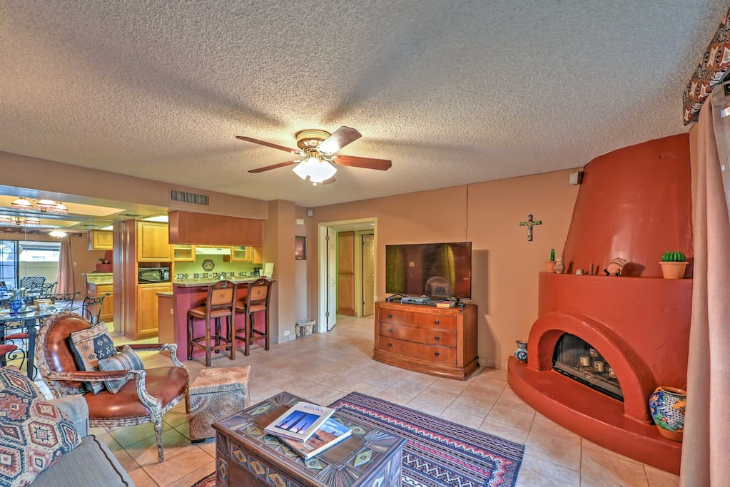 Spend quality time with loved ones in the living room as the red clay fireplace warms the room.
