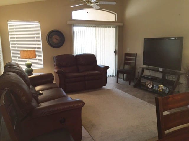 Relaxing living room with four lazy boy recliners in sofa.