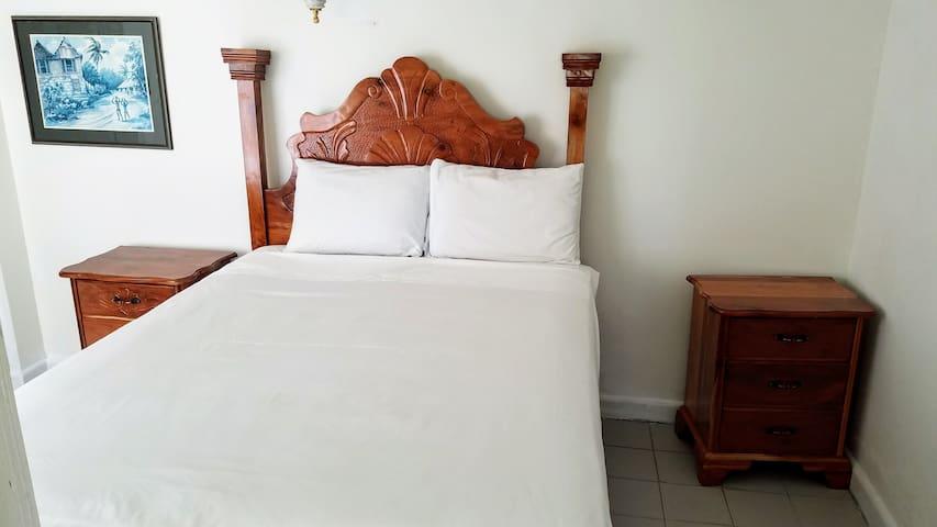 Queen-sized bed in bedroom #3