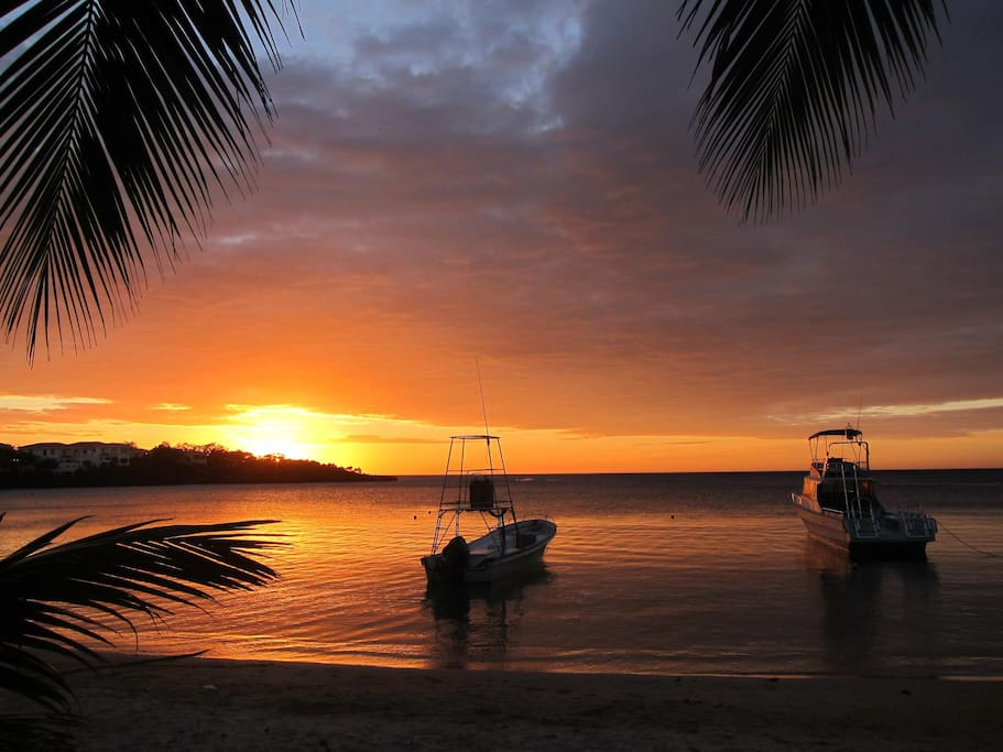 Sunset, from our beach, with our dive boats.