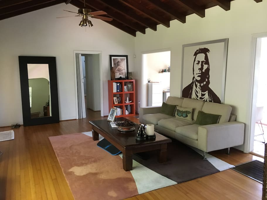 spacious living room w/ hardwood floors & mahogany vaulted ceiling