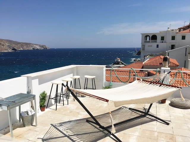Greece, Andros, Chora - Apt#2 Private Terrace with Amazing views, outdoor shower, hammock, hanging chair, grill, bar and lounge area.