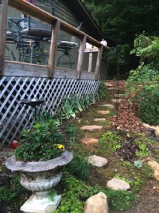 Stepping stone pathway beside deck. Peaceful and serene place to enjoy the mountain view.