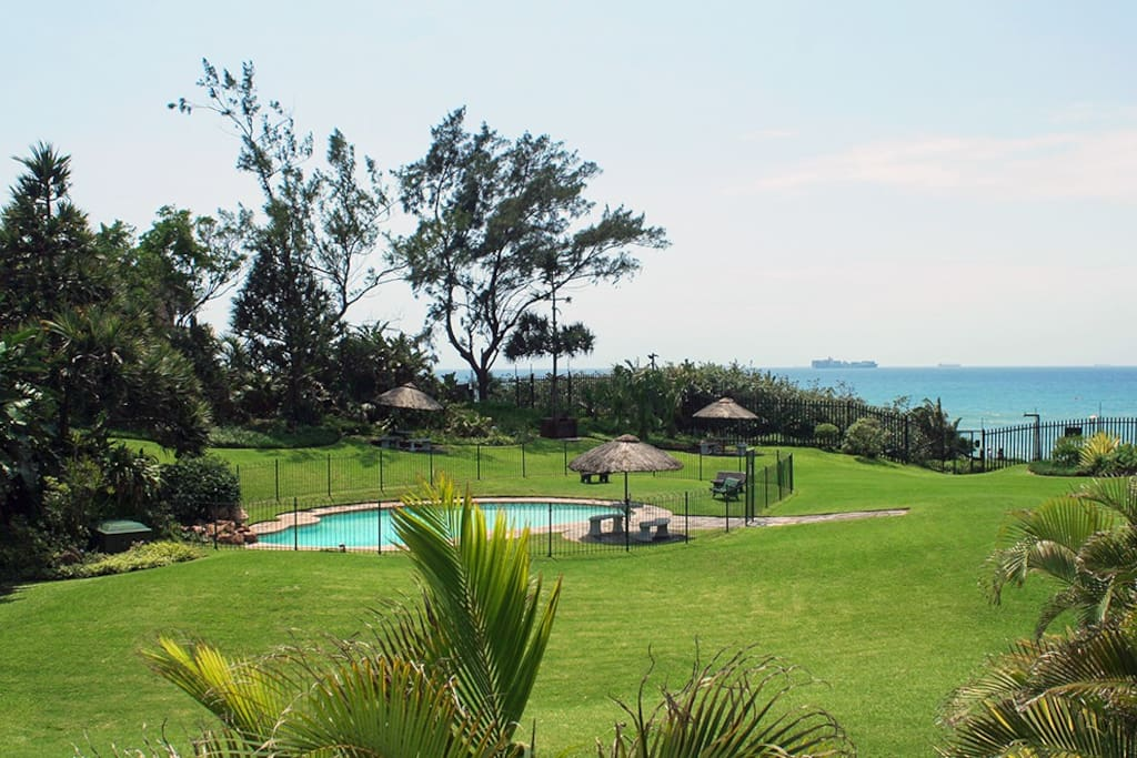 Large gardens with pool area and braai facilities