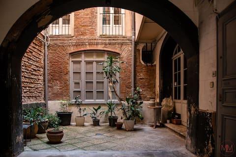 Appartement de charme hypercentre et son Patio.