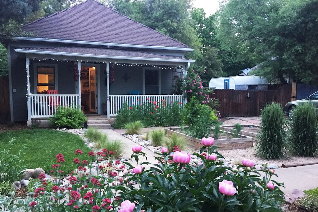 Enjoy the gardens and front porch with rocking chairs.