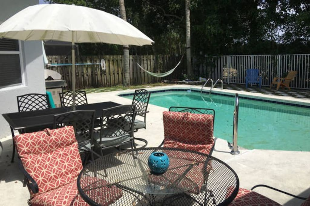 Pool with hammock in a shady area and a grill