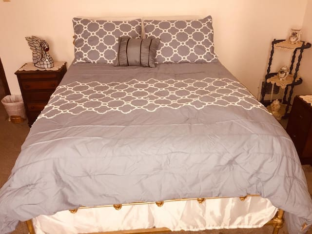 The third private bedroom has a double bed with easy access to the second floor full bath.
