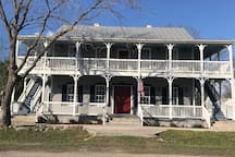 Lovely Historic Hotel in Comfort, Texas. One bedroom and/or two bedroom boutique hotel suites available.