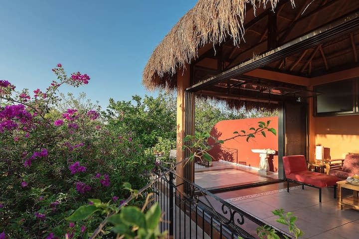 Palapa with doors open to rooftop terrace