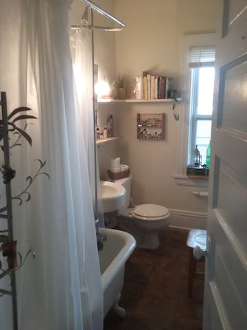 Clawfoot tub, candles, and plenty to read. Make yourself at home!