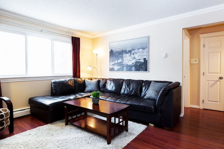 Spacious real leather sectional couch to kick back and relax.