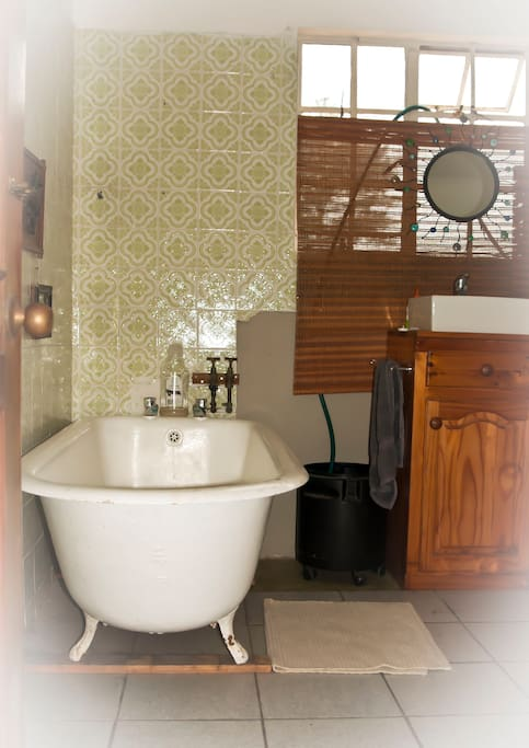 This is the Bathroom, with basin, wash machine & clothes horse.