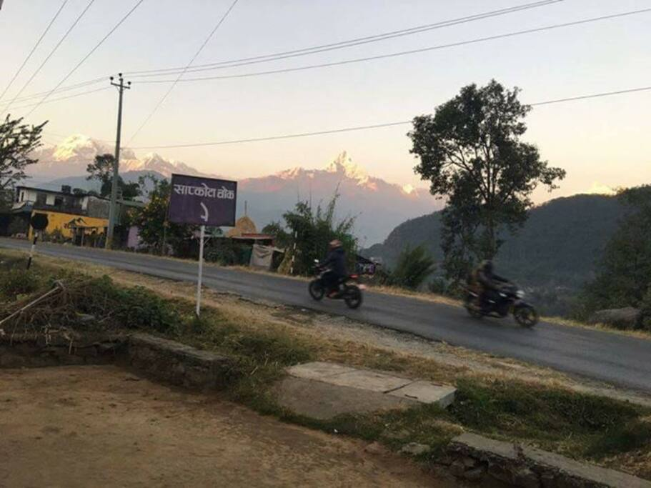 Front road with Annapurna mountain range view