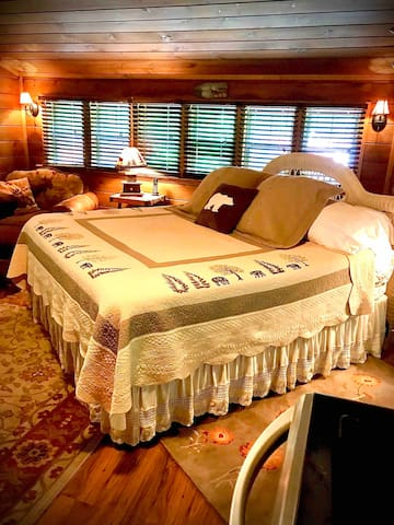 Sleep well on this king bed in  Adirondack theme decor.