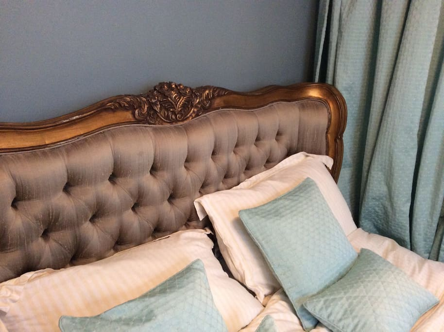 King size, distressed Louis-style bed with new mattress and feather pillows
