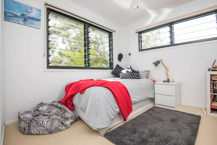 Upstairs room with single beds with wardrobe