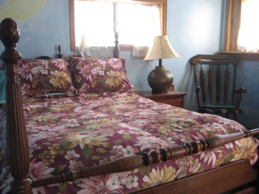 The Rose Room delights the eye with stained glass, stone fireplace, and old world comfort, roomy closet.