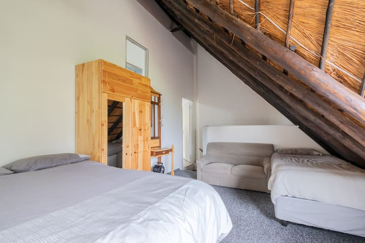 Loft bedroom with couch.  Spacious and carpeted