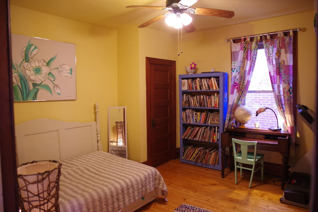 Your bedroom! There's an extensive book selection that you're welcome to read from, a vintage desk, and drawers and closet space available for your use.