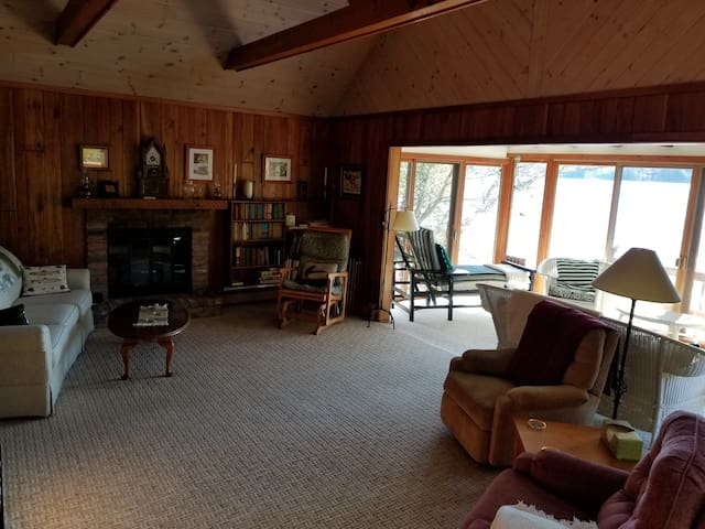 Combine the lake view and the warm ambiance of the gas log fireplace