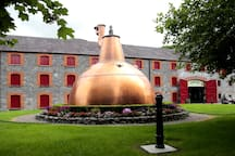 Jameson Whiskey distillery in County Cork. You can visit by local train from Cork and sample their output