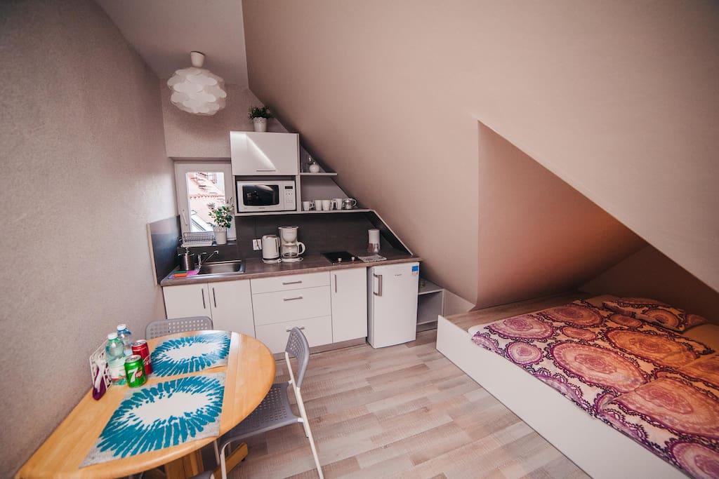 Apartament Górski - aneks sypialny i aneks kuchenny