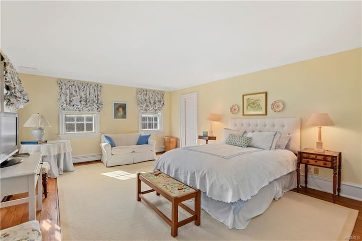 The Master Bedroom has sweeping views of the grounds, a TV and two large closets. The master bathroom is privately attached.
