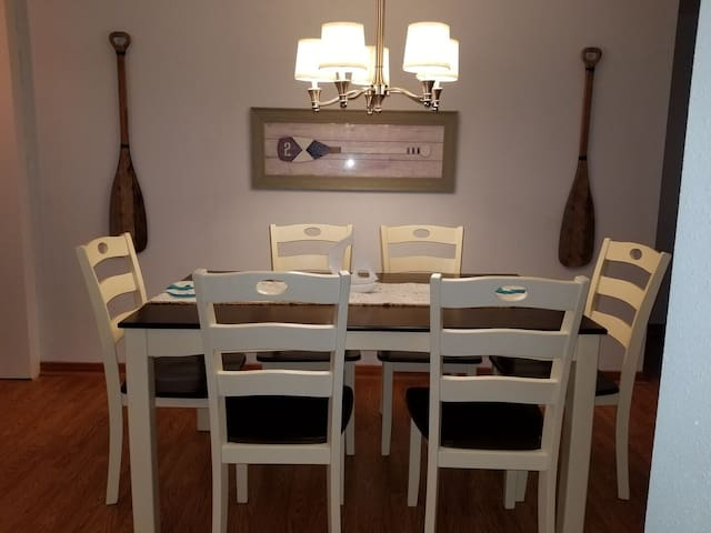 Dinner Table and Chandelier...great place for family game night or a good poker game too!