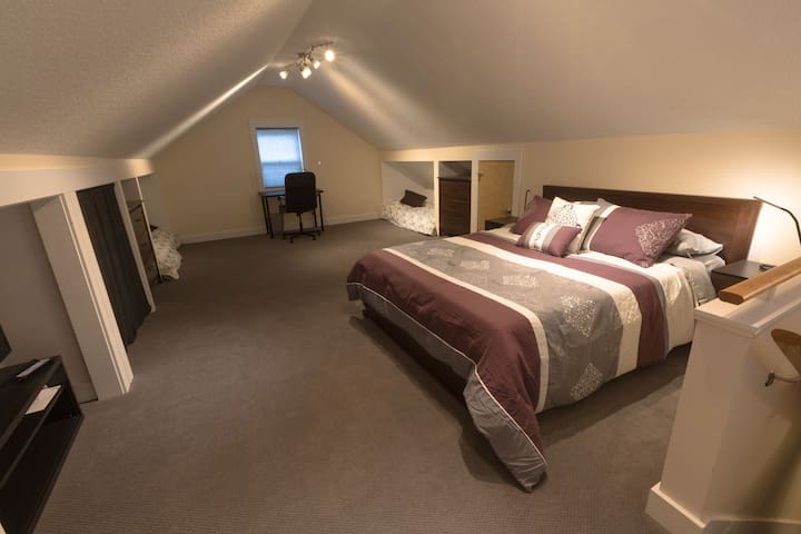Huge bedroom with Queen bed, two twin trundles,  desk, and two privacy screens